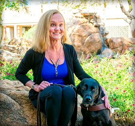 Author Debra M. Cooper with her loyal guide dog Portia